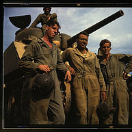 Tank crew standing in front of an M-4 tank, Ft. Knox, Ky. (LOC)