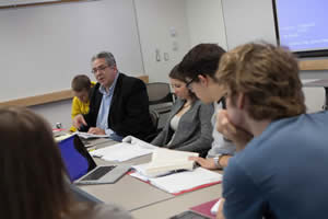 Greg Kaster leads a class discussion in his FTS class (Photo by Nick Theisen '15).