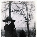 Woman walking down Hello Walk, 1916-20 - In this candid picture, a Gustie Gal is caught bundled up walking down Hello Walk. This photograph is courtesy of the Gustavus Adolphus College Archives. Visit them at https://gustavus.edu/library/archives/