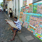 Photo gallery image named: painter_displays_his_wares_in_the_streets_of_salvador_-_brazil.jpg