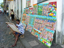 painter_displays_his_wares_in_the_streets_of_salvador_-_brazil.jpg