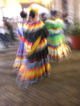 Latina women in colorful garb
