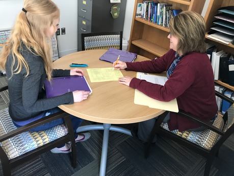Here is a photo of Kim Meyer meeting with a student about getting started in the Education Department.
