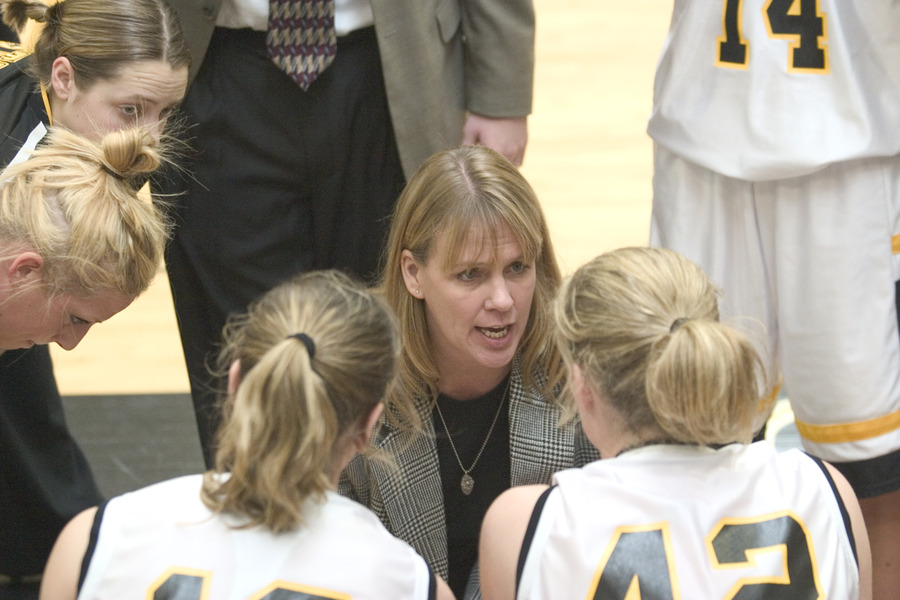 Coach Mickey Haller gives her team direction in the huddle