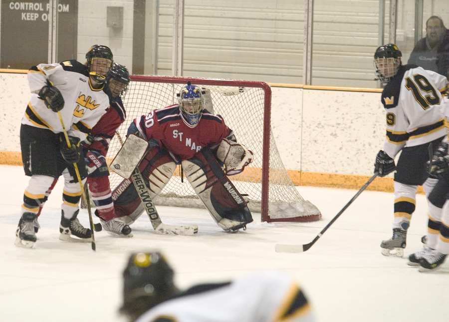 Two Gusties wait in front of the goal for a rebound.