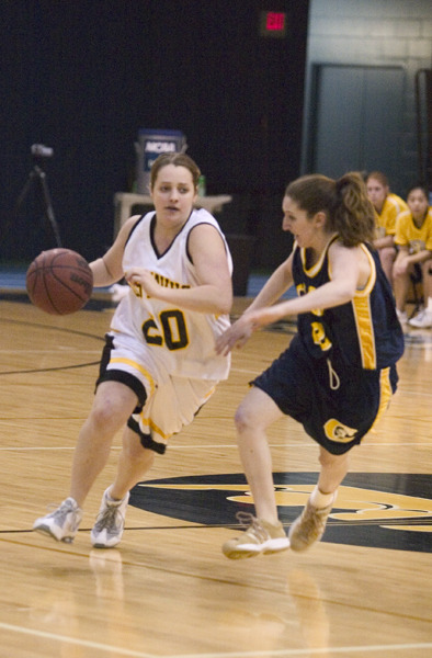 Marit Sviggum dribbles past a Carleton defender.