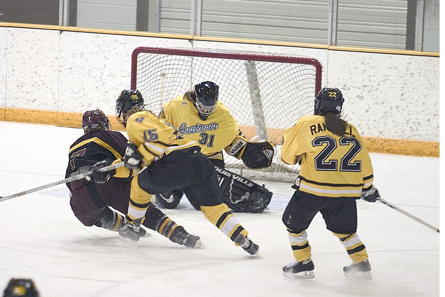 Goaltender Kara Meyer stops Concordia forward Hannah Impola from point blank range.