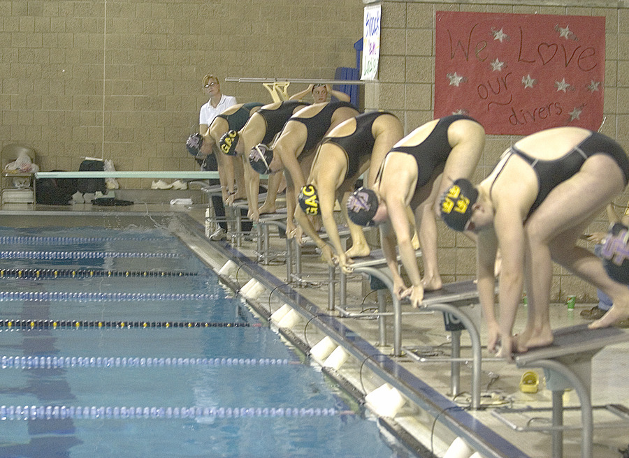 The women prepare for the start of the 400 individual medley.