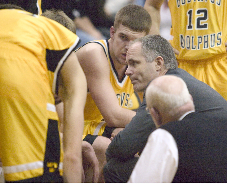 Mark Hanson confers with his team during a timeout.