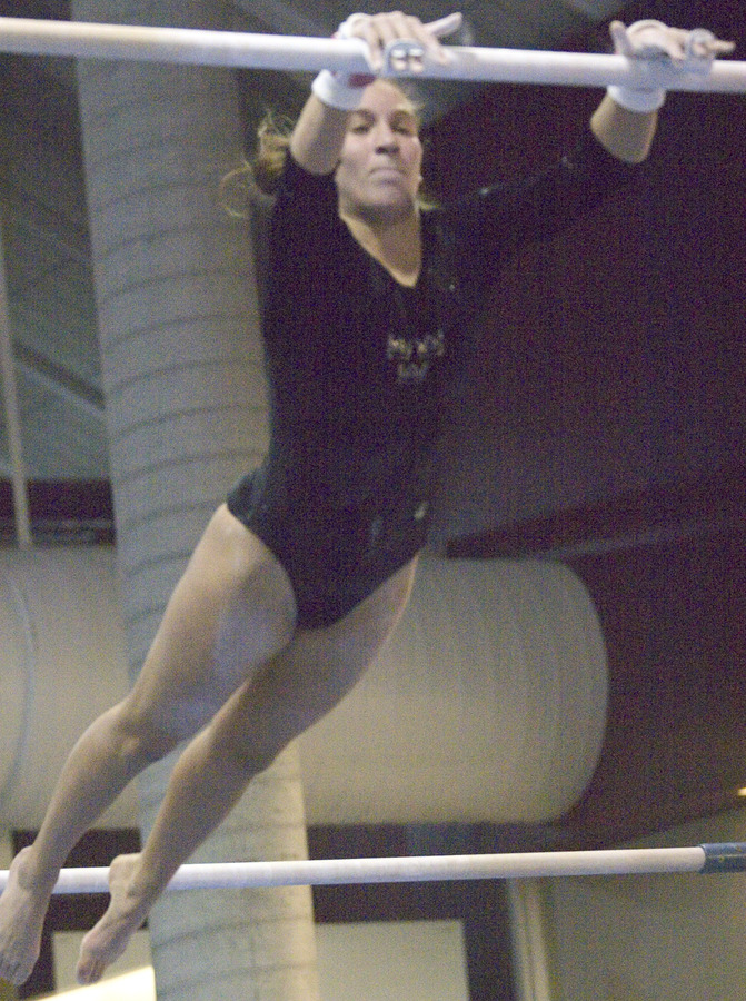 Amanda Parker performs her first place bar routine.