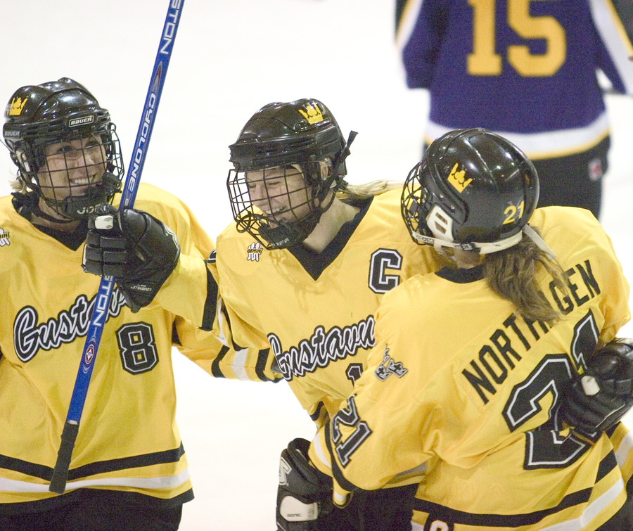 Senior captain Leah Erickson celebrates her goal with linemates Tana Tuomie and Brittany Northagen.
