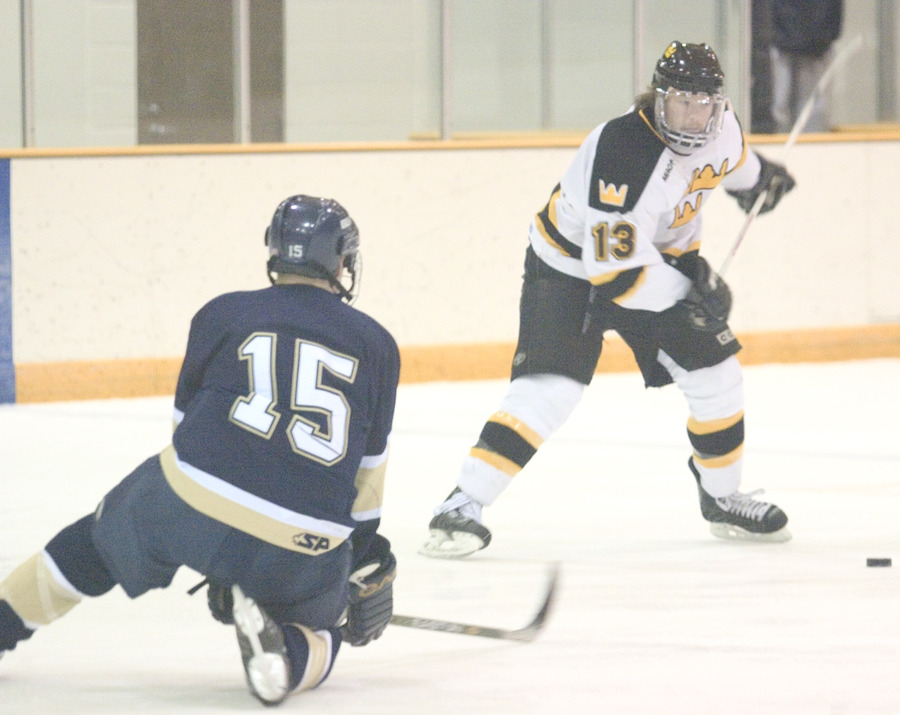 Gustie defenseman Keith Detlefsen winds up for the slap shot.