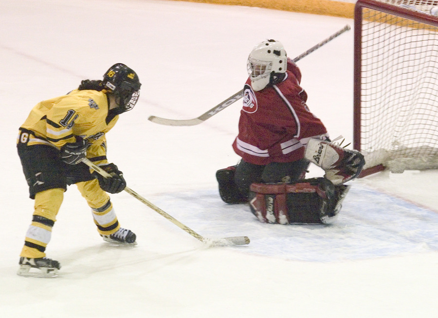 Ingrid Neve scores one of her two goals for the Gusties.