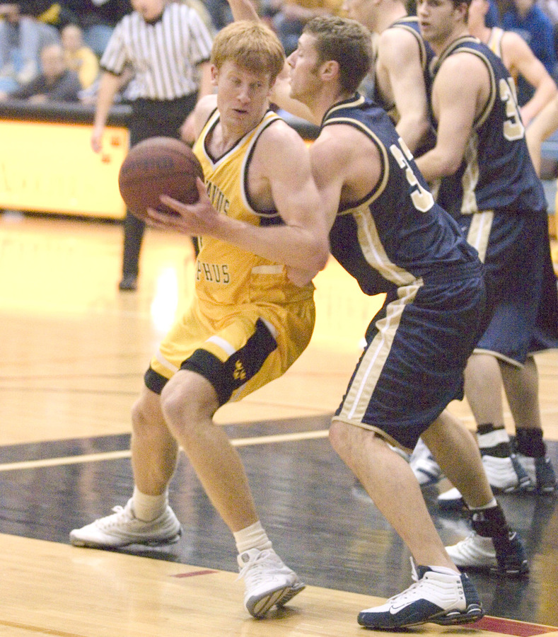 Doug Espenson gets set to make a post move against a Bethel defender.