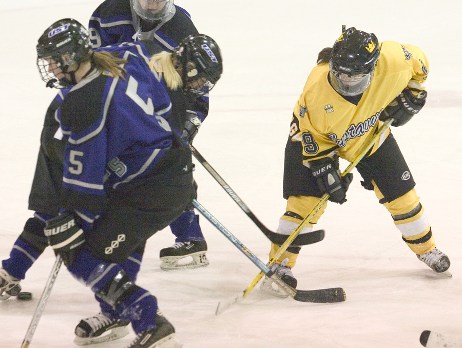 #9 Kelly Crandall works for the puck against St. Thomas.