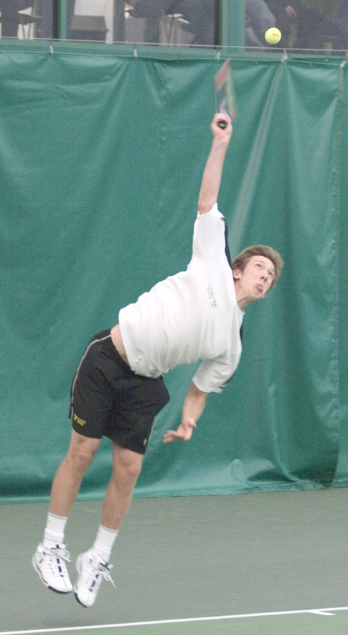 Roy Bryan unloads on a first serve in his singles match.