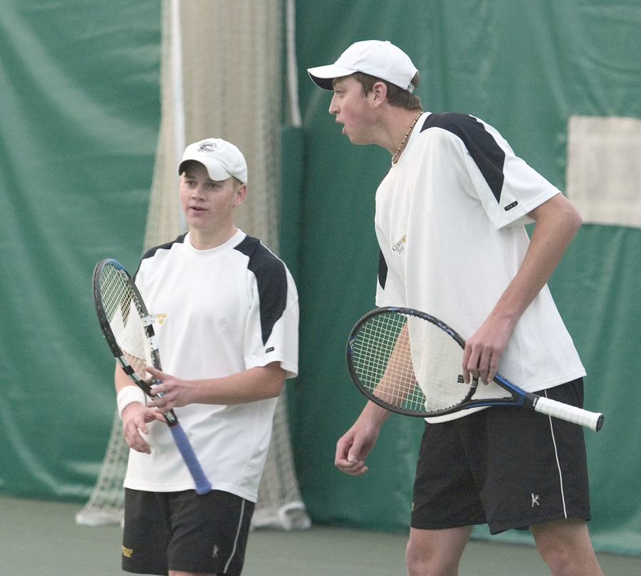 Adam Morgan (left) and Brett Morse-Karzen (right) discuss strategy in their doubles match.