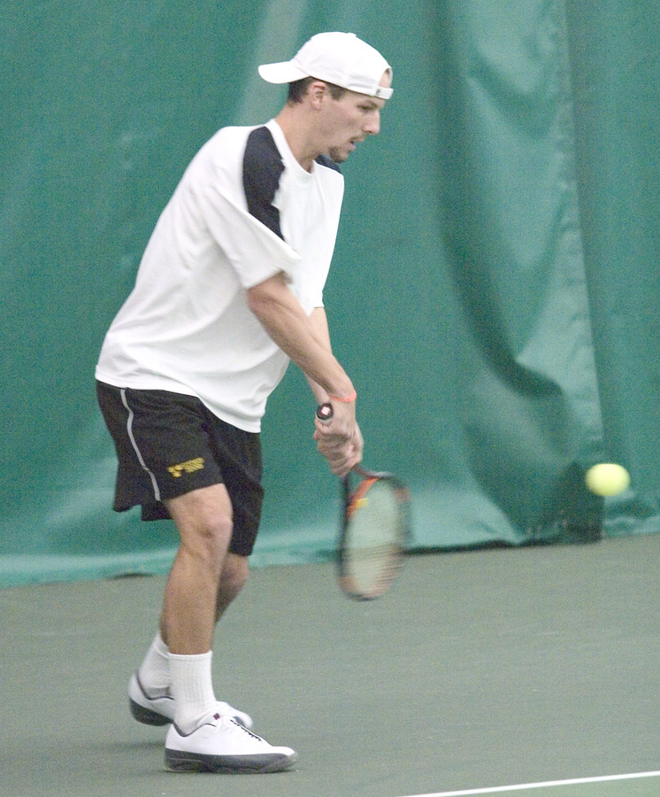 Jesse Brauer prepares to hit a backhand return.