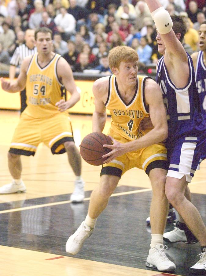 Doug Espenson scores two of his game-high 30 points.