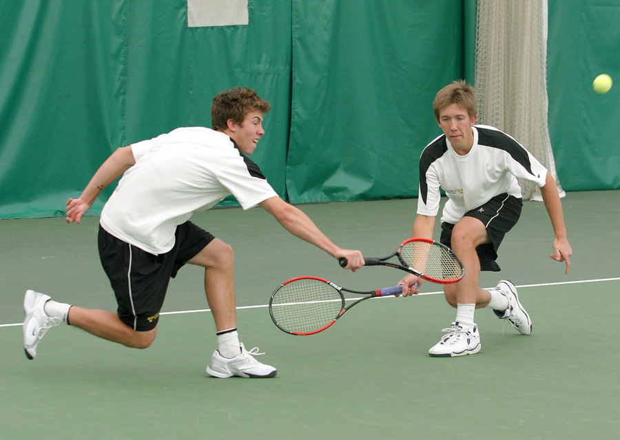 Andy (left) and Roy Bryan return a volley in the #3 doubles match.
