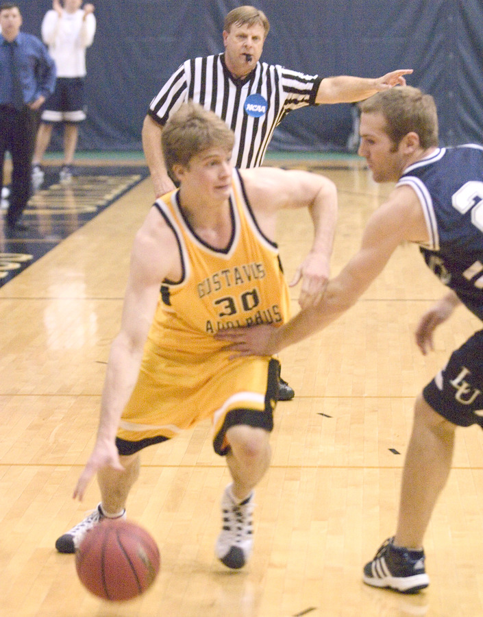 Andrew Olson drives past a Lawrence defender.