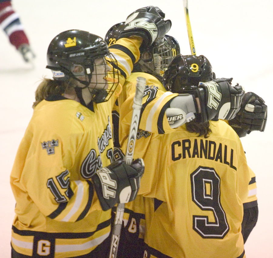Gustavus celebrates one of its five goals on Thursday night.