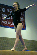 Amanda Parker performs on the balance beam.