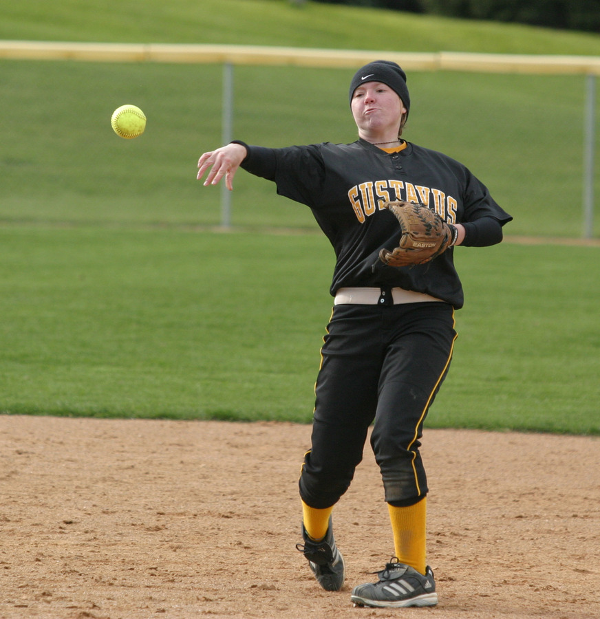 Shortstop Meghan Powers throws a runner out at first.