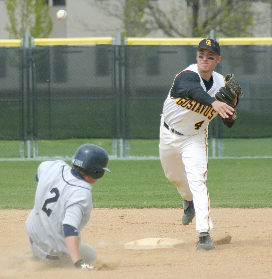 Second baseman Travis Gunderson fires to first to complete a double play.