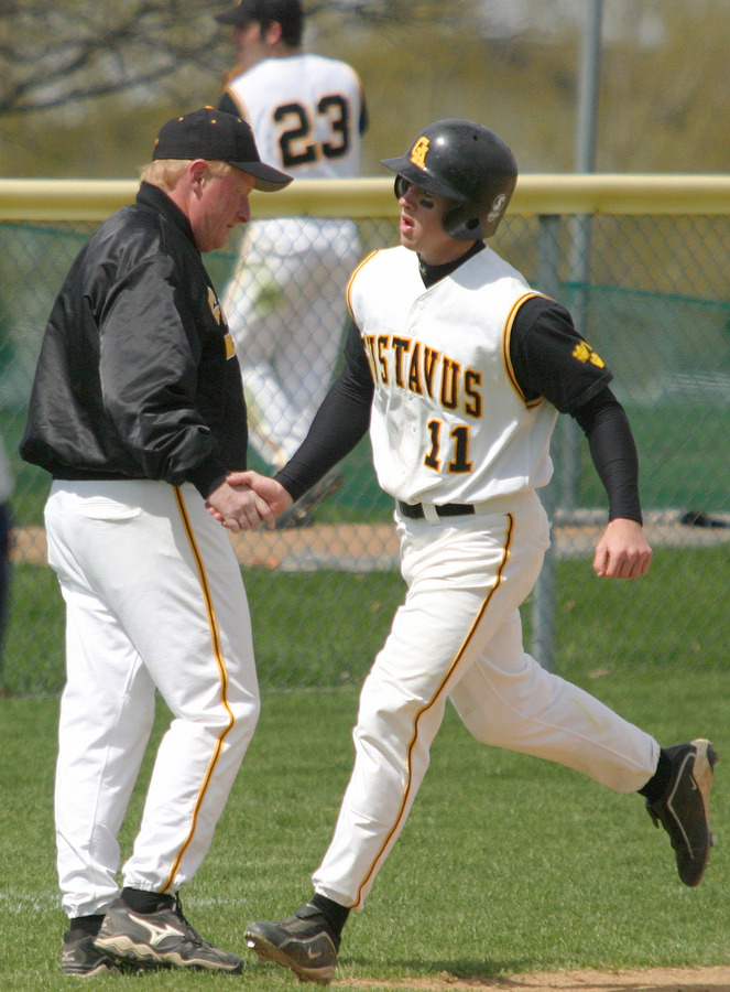 Wade Vrieze is congratulated by Coach Carroll after hitting a two-run home run in game one.