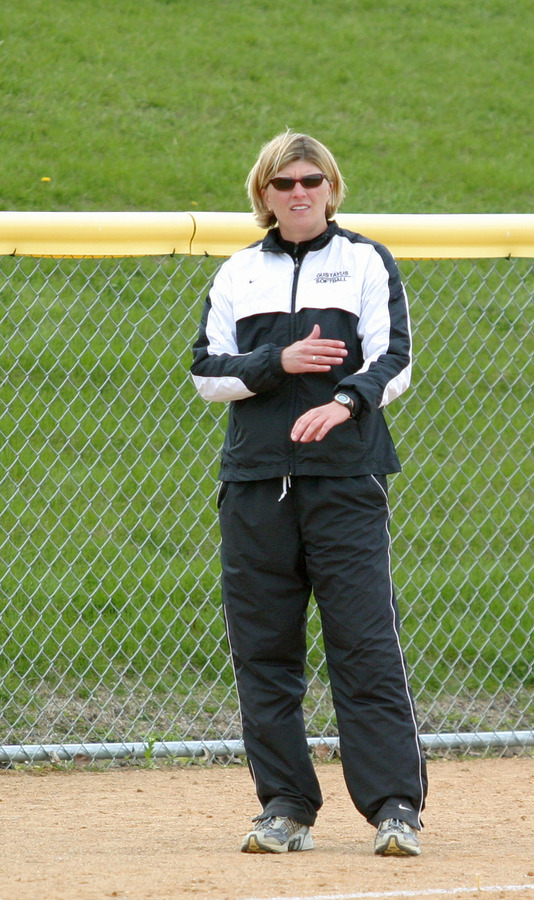 Head Coach Shanda Ness relays her signals from the third base coaches box.