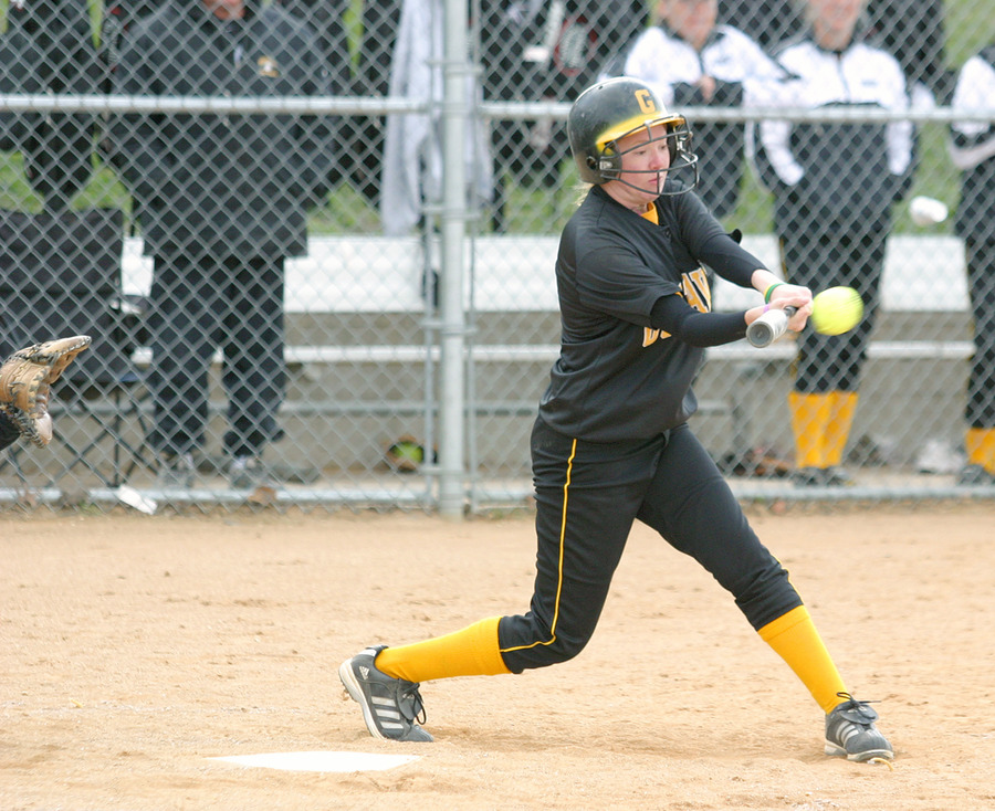 Meghan Powers drives a triple to deep left field in the first inning of the first game.