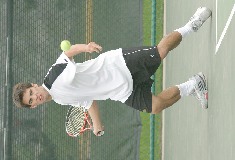 Danny Suchy returns a forehand in his doubles match.