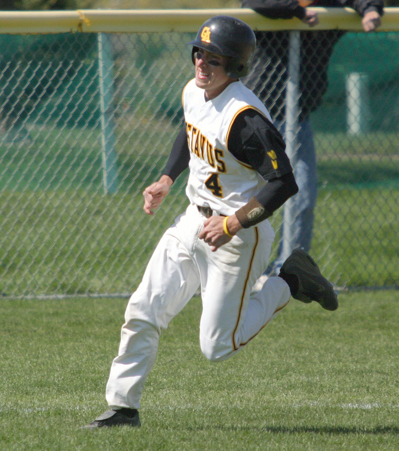 Travis Gunderson rounds third and heads for home in the second inning.