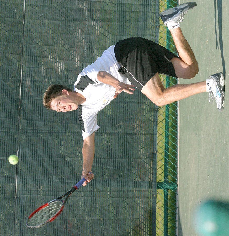 Roy Bryan scrambles to hit a forehand.