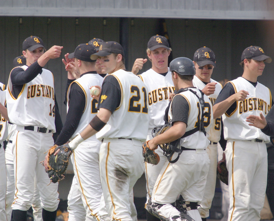 The Gusties celebrate a Mother's Day sweep against Simpson College.