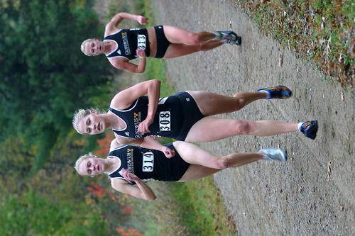 Gustavus runners Laura Edlund, Mollie Lager and Melissa Kittock