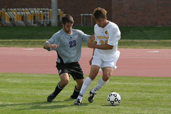 Forward Alex Groth tries to outmaneuver his opponent.
