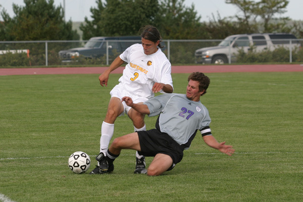 Midfielder Chris Pinahs battles Bob Moelter of Whitewater for possession of the ball.