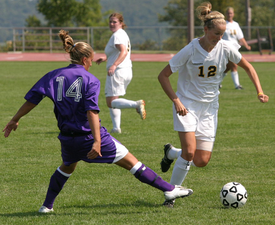 Liz Petersen dribbles past a UW-Stevens Point defender.