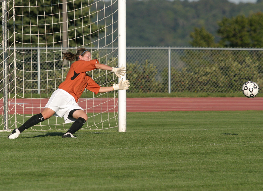 Tori Boughton dives to make a big save late in the match.