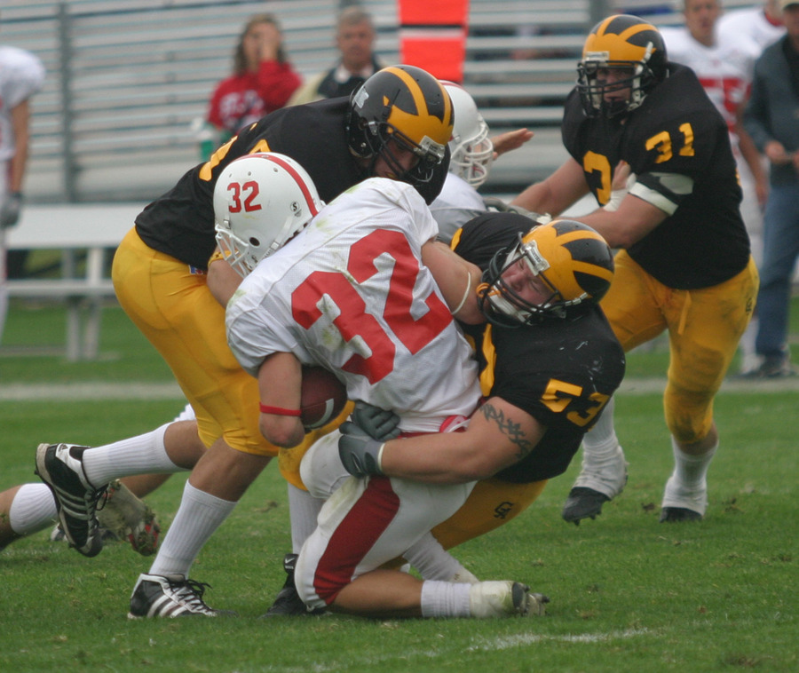 Defensive tackle Nick David teams with Jared Chapman to take down Johnnie running back Mike Lofboom.