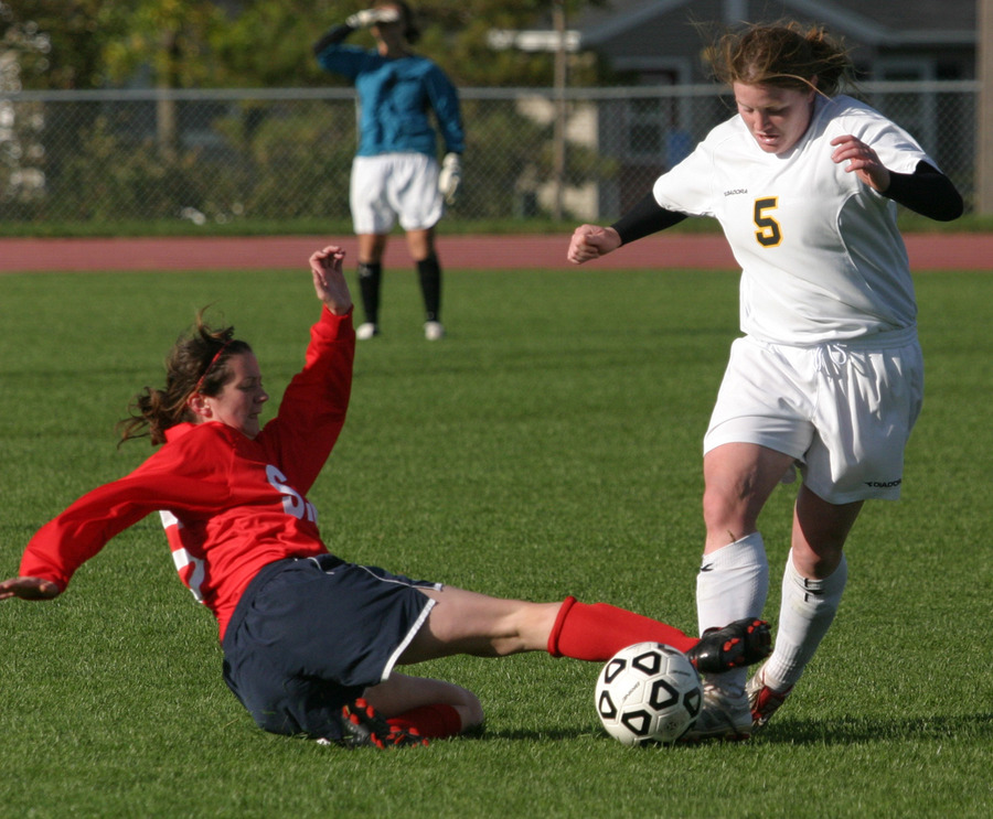 Junior defender Shannon Quealy takes the ball away from a Cardinal attacker.