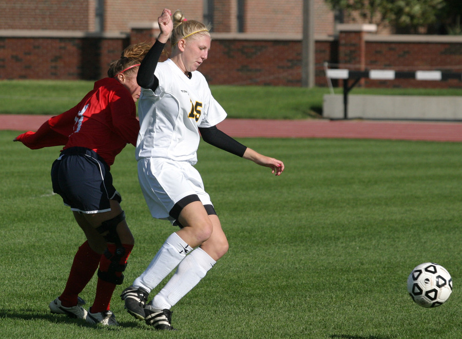 First year defender Rachel Gieseke looks  to clear the ball for the Gusties.