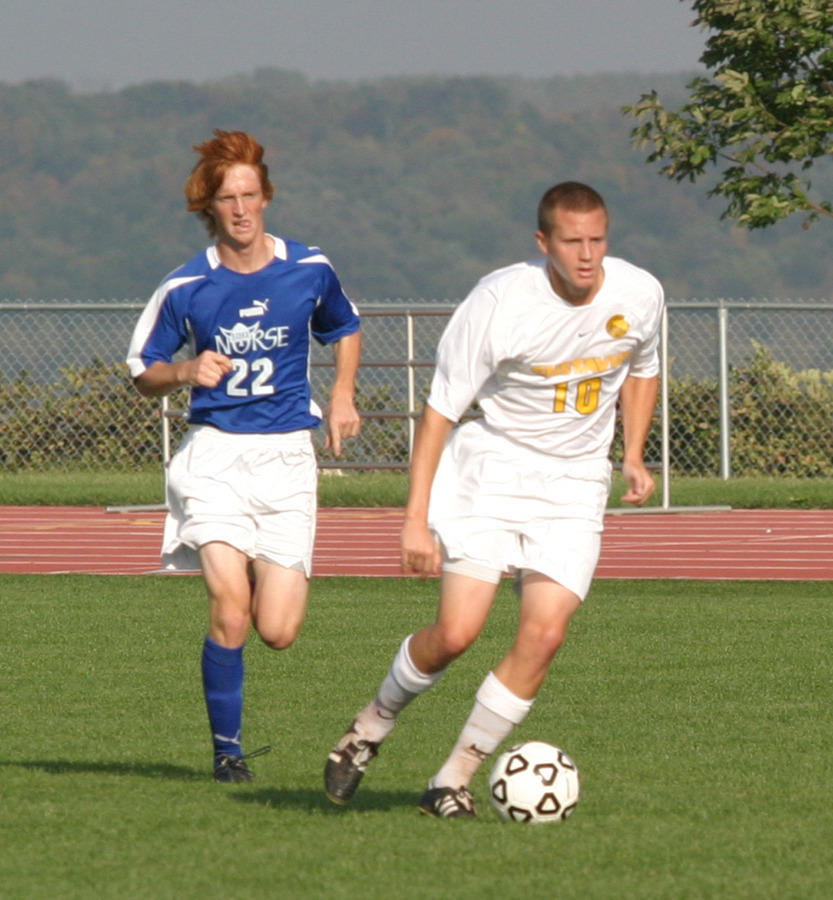 Bobby Kroog runs the ball away from a Luther defender