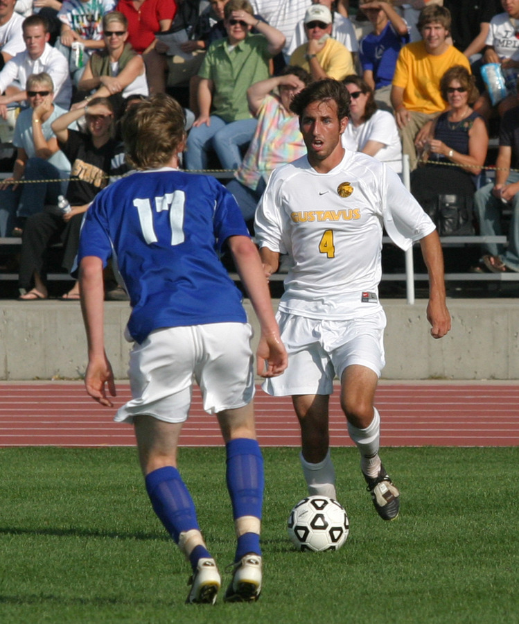 Jeff Aasness pushes the ball toward a defender