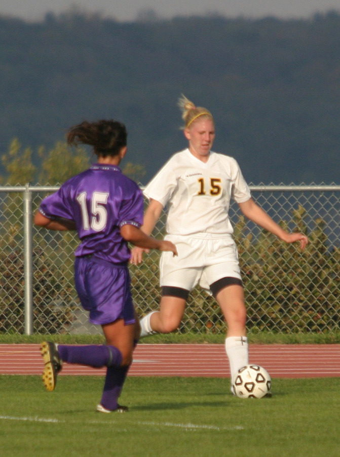 Rachel Gieseke passes the ball to a teammate