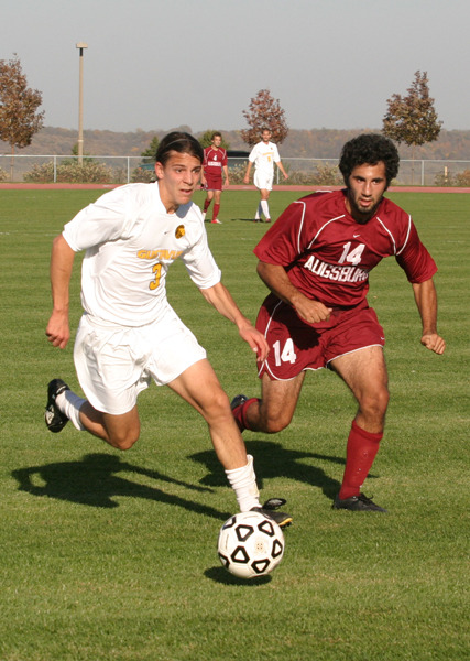 Midfielder Chris Pinahs dribbles past an Auggie defender.