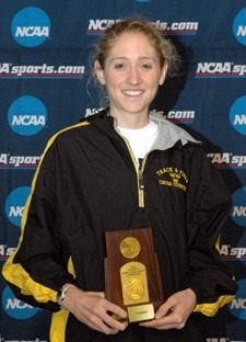 Gustavus junior Hailey Harren with her championship trophy