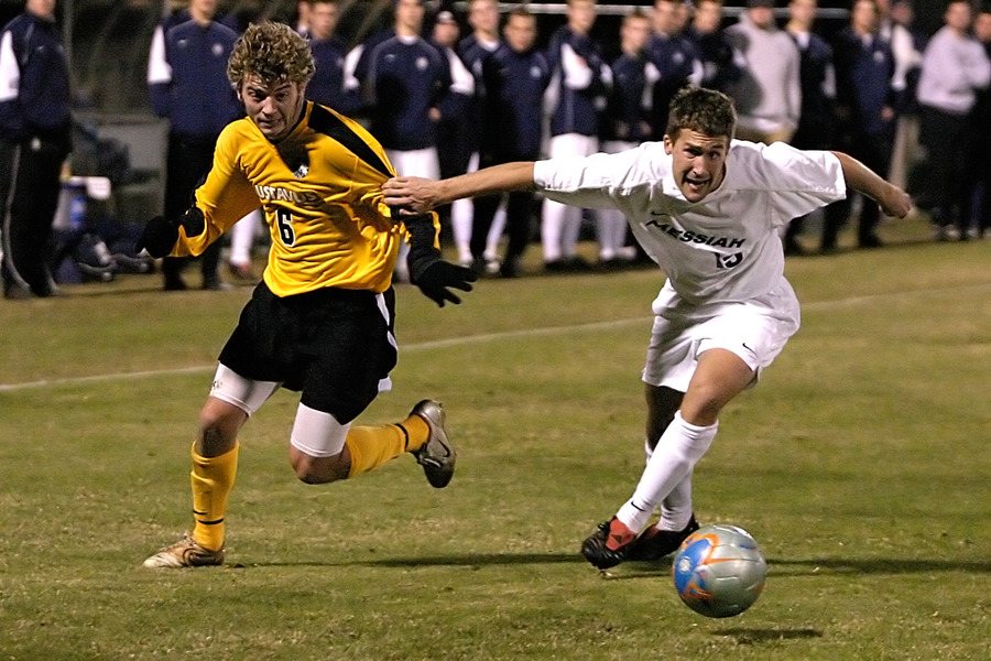 Sophomore Jeffrey Johnson battles with a Messiah defender.